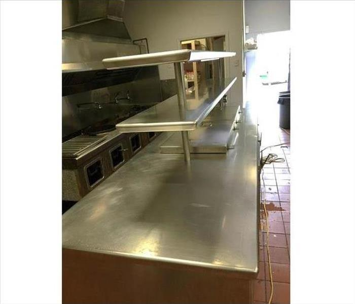 Restaurant kitchen counter fully cleaned with no food or debris
