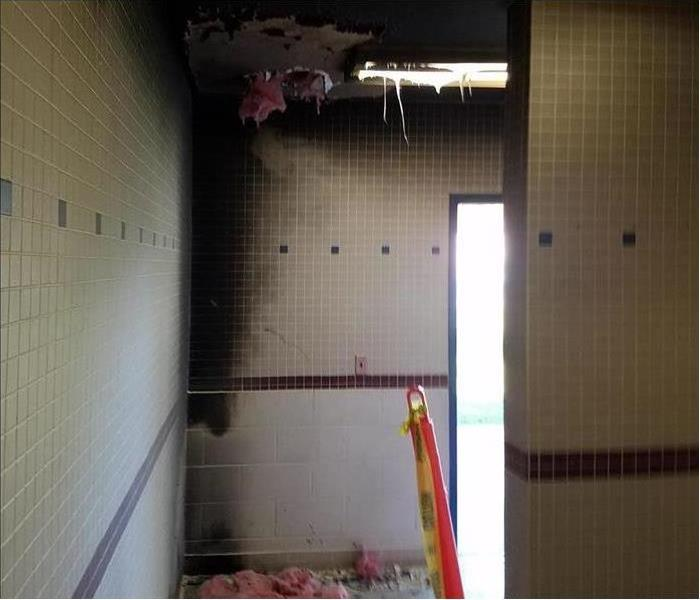 School bathroom showing considerable fire and soot damage