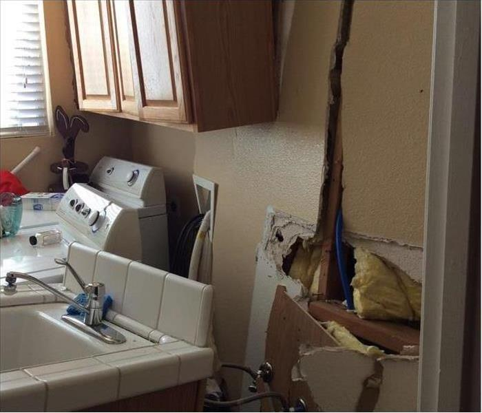 Laundry room wall crashed into and washer/dryer moved